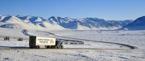 Dalton highway and oil pipeline at Atigun pass, truck, Alaska
